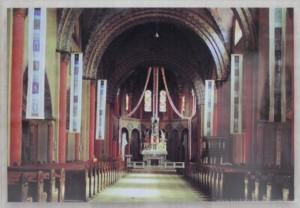 Pierwotna polichromia na pocztówce z lat 90. XX wieku.